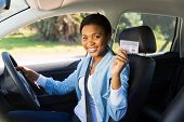 picture of seatbelt  - pretty african woman in a car showing her driver - JPG