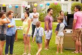 stock photo of niece  - Multi Generation Family Enjoying Party In Garden Together - JPG