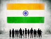 stock photo of indian flag  - Indian Flag and a group of business people - JPG