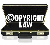 foto of lawyer  - Copyright Law words and c symbol in 3d letters in a black leather briefcase of an attorney or lawyer in an infingement lawsuit against piracy - JPG