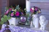 stock photo of dowry  - Flower arrangement in a basket decorate the wedding table in purple tones - JPG