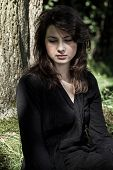 stock photo of grieving  - Portrait of young grieving woman in black - JPG