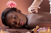 image of reflexology  - Side view of young woman undergoing acupuncture therapy at beauty salon - JPG