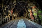 image of tunnel  - The nine hundred foot Nada Tunnel located in the Red River Gorge Wilderness is a one lane tunnel on a two lane road - JPG