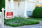 stock photo of borrower  - Home for sale Real estate sign in front of new house - JPG