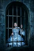 pic of dungeon  - Woman in victorian dress imprisoned in a dungeon - JPG
