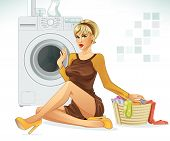 stock photo of wifes  - Beautiful blonde house wife is doing laundry - JPG