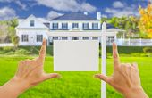 picture of real  - Female Hands Framing Home Blank Real Estate Sign in Front of New House - JPG