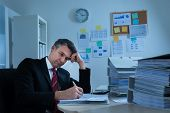 stock photo of boredom  - Portrait Of Boredom Mature Businessman With Stack Of Folders - JPG