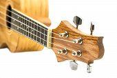 stock photo of ukulele  - Closeup of ukulele hawaiian guitar isolated on white background - JPG