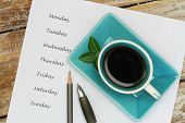 picture of weekdays  - Coffee and weekdays listed on white piece of paper - JPG