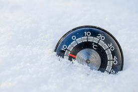 foto of temperature  - Thermometer in the snow shows low temperature - JPG