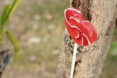 stock photo of valentine candy  - Candy valentines hearts on a background of wooden - JPG