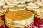 foto of masonic  - many lid tops closeup of mason jars - JPG