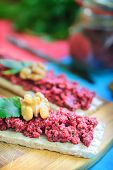 image of chickpea  - Beetroot and chickpea hummus canapes decorated with parsley and walnut - JPG