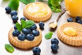 image of curd  - Process of making shortbread tartlet filled with lime curd and blueberries on old vintage metal background - JPG