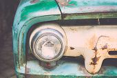 image of muscle-car  - Close up headlight of a vintage car with vintage filter effect - JPG