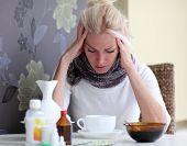 pic of sick  - Sick young woman having vitamins and had headache  - JPG
