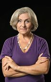 pic of beautiful senior woman  - Portrait of a beautiful senior woman on black background - JPG