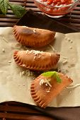 pic of patty-cake  - homemade tuna patty with tomato sauce on wooden table - JPG