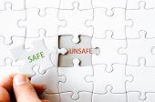 picture of unsafe  - Hand with missing jigsaw puzzle piece - JPG