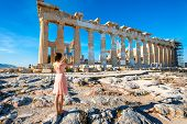 stock photo of parthenon  - Young woman photographing with digital tablet Parthenon temple in Acropolis - JPG