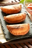 image of patty-cake  - homemade tuna patty with tomato sauce on wooden table - JPG