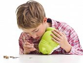 foto of thrift store  - The boy gets money from the piggy bank - JPG
