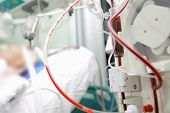 stock photo of bp  - Patient on cardiopulmonary bypass device in the intensive care unit - JPG