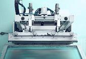 stock photo of silkscreening  - Retro printing press in the silkscreen technique - JPG