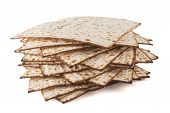 stock photo of matzah  - Matzot for pesach pile isolated on white background - JPG