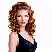 stock photo of black curly hair  - Portrait of beautiful woman in black dress with curly hair  - JPG