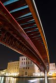 image of calatrava  - The Constitution Bridge Venice at night vertical It is the fourth bridge over the Grand Canal and was designed by Calatrava and was moved into place in 2007 - JPG