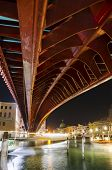 picture of calatrava  - The Constitution Bridge Venice at night vertical It is the fourth bridge over the Grand Canal and was designed by Calatrava and was moved into place in 2007 - JPG