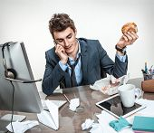 image of loafers  - Talking on the phone and looking down modern office man at working place sloth and laziness concept - JPG