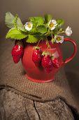 stock photo of jug  - ripe juicy berries and jug on piece of wood - JPG