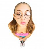 stock photo of nerd  - Funny schoolgirl with nerd glasses isolated - JPG