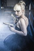 pic of pistols  - Armed blonde with pistols and dressed in costume ballet dancer - JPG