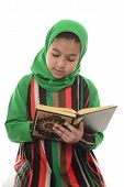 stock photo of muslimah  - Little Young Muslim Girl Reading Holy Quran Isolated on White Background - JPG