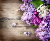picture of violet flower  - Lilac flowers bunch over wooden background - JPG