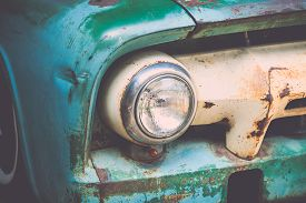 stock photo of muscle-car  - Close up headlight of a vintage car with vintage filter effect - JPG