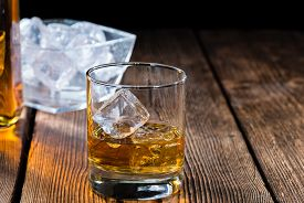 picture of malt  - Single Malt Whiskey with Ice Cubes on wooden background - JPG