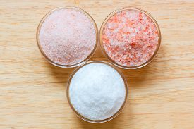 picture of crystal salt  - Himalayan pink salt and white sea salt in the glass bowls on wooden background - JPG