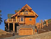 picture of log cabin  - full log cabin home exterior with warm fireplace  - JPG