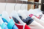 Sport clothes on hangers poster