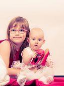 Постер, плакат: Two Little Sisters Portrait