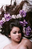 stock photo of asian woman  - Beautiful asian woman with flowers on her hair - JPG