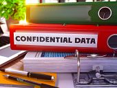 Confidential Data on Red Office Folder. Toned Image. poster