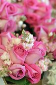 picture of pink rose  - a grouping of pink bridal bouquets- pink roses and baby