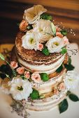 Постер, плакат: Wedding cake with roses whipped cream